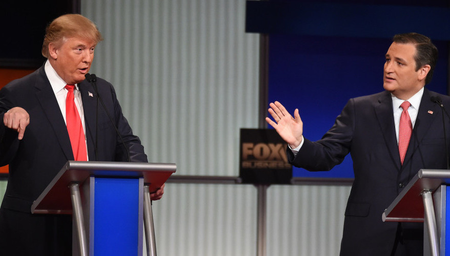 Donald Trump speaks and Sen. Ted Cruz, R-Texas, responds during Thursday night's Republican presidential debate in North Charleston, S.C.