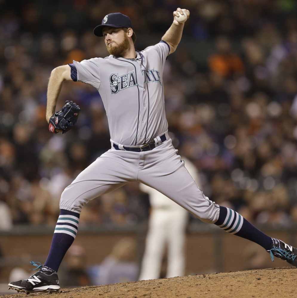 Charlie Furbush, a South Portland native, avoided salary arbitration by signing a one-year deal to return to the Seattle Mariners. He's pitched for Seattle since 2011.