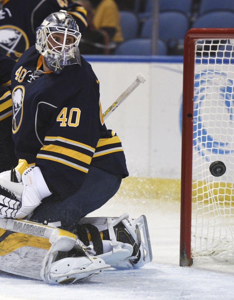 Sabres goaltender Robin Lehner looks at the puck behind him on the game-tying goal by the Bruins' Matt Beleskey in the second period.