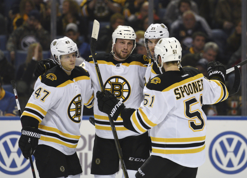 Bruins Torey Krug (47), Matt Beleskey (39), Loui Ericsson (21) and Ryan Spooner (51) celebrate a goal by Beleskey in the second period of Friday night's win over the Buffalo Sabres.