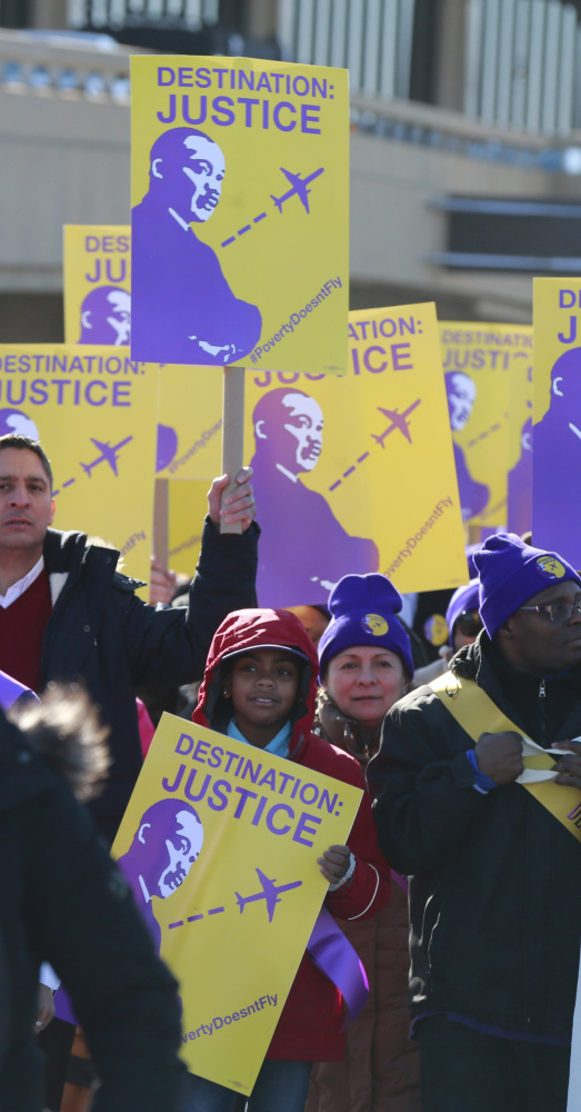 Union members in Newark, N.J., march at Newark Liberty International Airport on Monday to bring attention to their request for a $15-an-hour minimum wage.