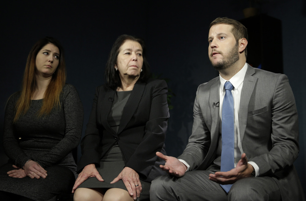 Christine Levinson, center, wife of Robert Levinson, and her children, Dan and Samantha Levinson, talk to reporters in New York on Monday. Robert Levinson, a former FBI agent, disappeared in Iran almost nine years ago.