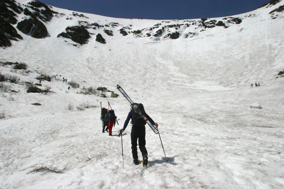 Skiers enter the bowl of Tuckerman Ravine in 2003. Kaj Huld was ascending a slope in the ravine below two climbers in The Chute, which runs between the two rock outcroppings at upper left, when unstable snow let loose and swept them away.