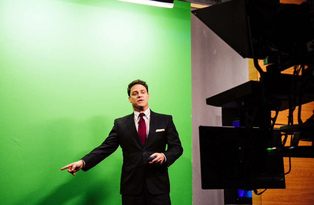 "WCSH-TV meteorologist Tom Johnston presents the weather report during the 5 p.m. news broadcast Tuesday. Viewers see the weather maps and text on the ""green screen"" behind Johnston, who had correctly predicted the snow accumulation for Monday."