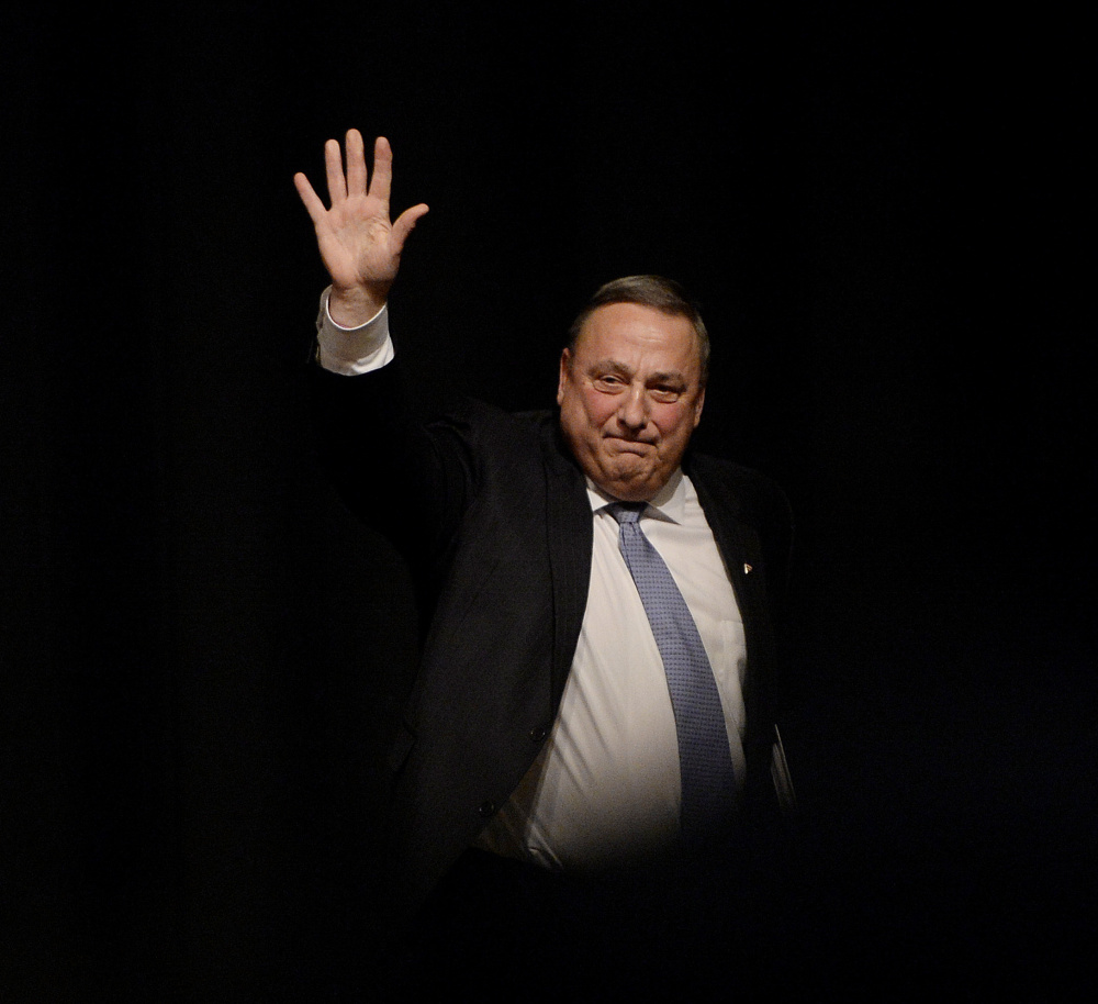 Gov. LePage waves to the crowd as he leaves the stage at Windham High School on Tuesday night.