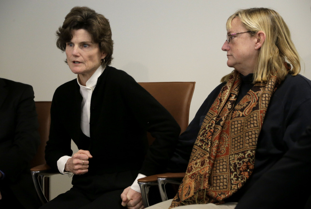 Anne Scott, of Charlottesville, Va., left, and Katie Wales Lovkay, of Granby, Conn., right, who stated they were sexually assaulted at St. George's School as students, face reporters at a news conference in Boston earlier this month.