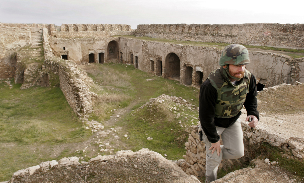 Columnist Bill Nemitz climbs stairs at the St. Elijah monastery on Dec. 24, 2004 in Mosul, Iraq. Satellite imagery shows Islamic State militants destroyed the ancient site.