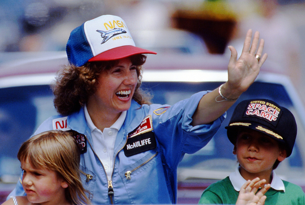 Christa McAuliffe, who was chosen to become the first teacher in space, rides with her children Caroline, left, and Scott during a parade in Concord, N.H., in 1985.