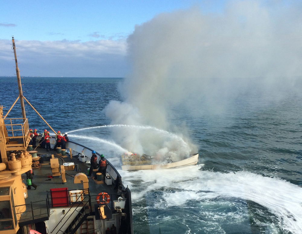 Crew from the U.S. Coast Guard cutter Willow extinguish a fire aboard the Miss Lynn off Port Clyde on Thursday morning.