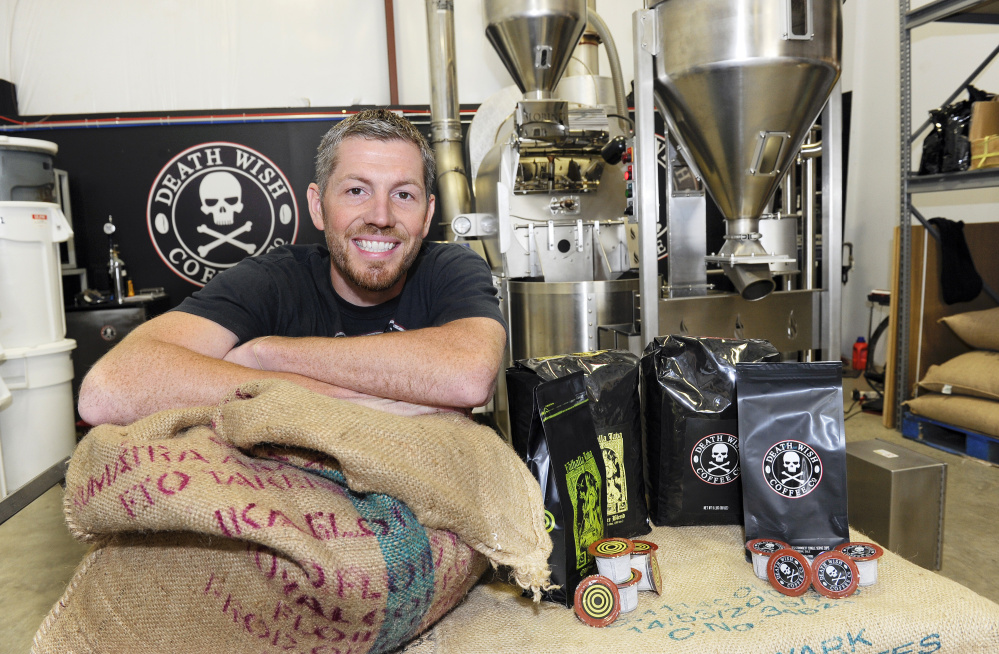 Michael Brown, owner of Death Wish Coffee Company, poses for a picture during Intuit QuickBooks Small Business Big Game finalists tour, in Round Lake, N.Y. Death Wish Coffee Co. won a competition held by software maker Intuit for a 30-second spot during the third quarter of the Super Bowl.