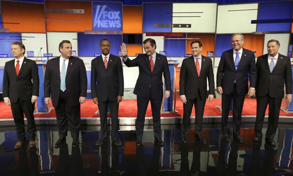 Republican presidential candidates Rand Paul, Chris Christie, Ben Carson, Ted Cruz, Marco Rubio, Jeb Bush and John Kasich largely sidestepped direct confrontations with each other at Thursday night's debate in Des Moines, Iowa, instead focusing most of their attacks on Hillary Clinton and throwing a few barbs at the absent Donald Trump.