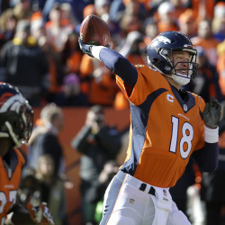 Denver Broncos quarterback Peyton Manning (18) reaches back to pass during the first half. The Associated Press