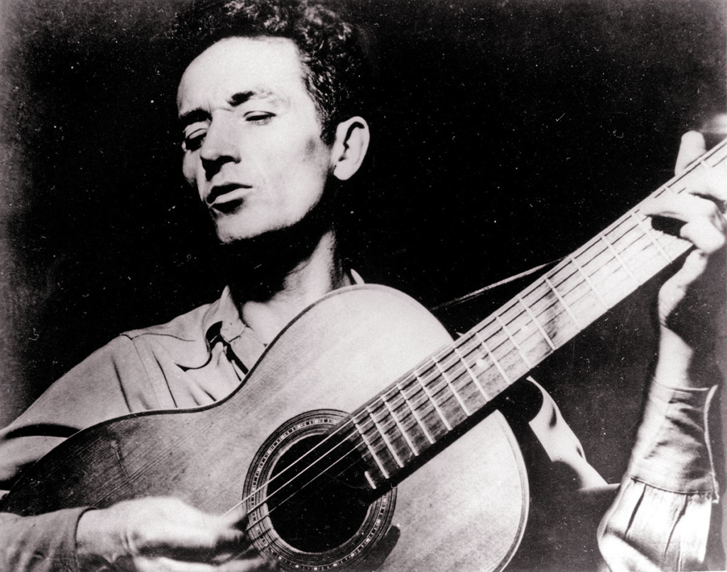 Folk singer Woody Guthrie wrote hundreds of songs, celebrating migrant workers, pacifists, and underdogs.  Undated photo by the Associated Press