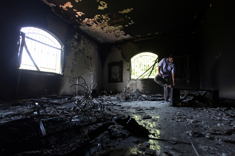 A Libyan man investigates the inside of the U.S. Consulate in September 2012 after an attack that killed four Americans, including Ambassador Chris Stevens, on the night of Sept. 11, 2012, in Benghazi, Libya.
