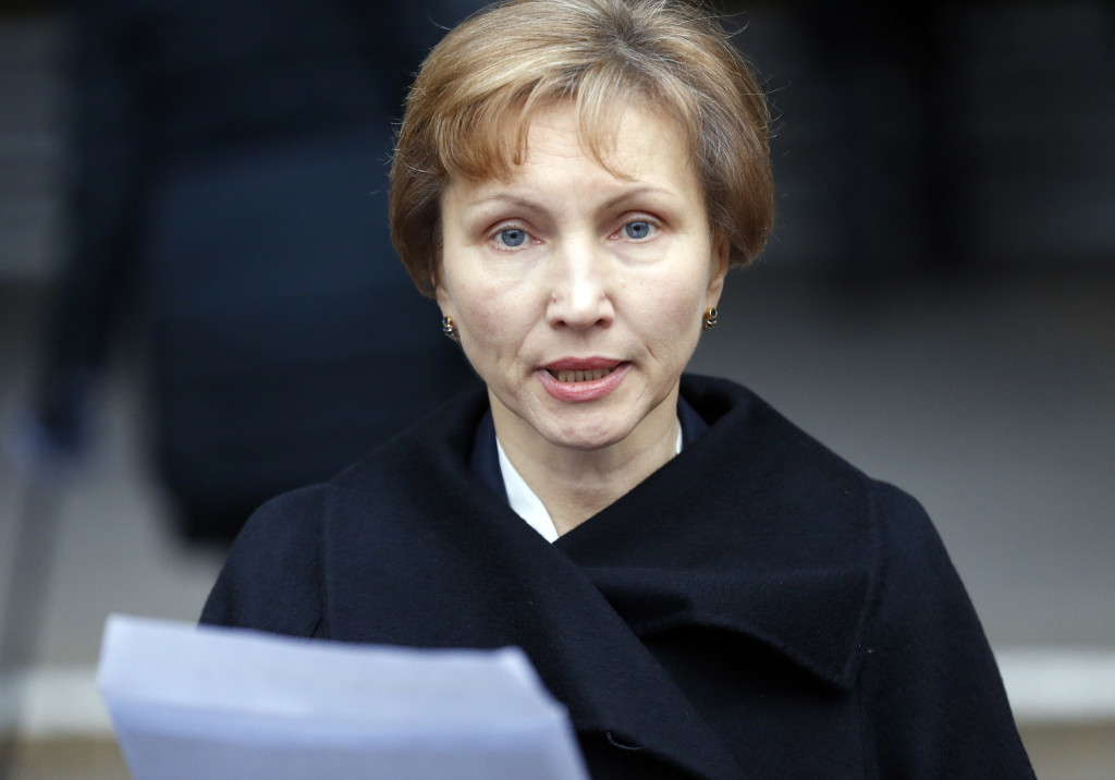 Marina Litvinenko, widow of former Russian spy Alexander Litvinenko, reads a statement outside the Royal Courts of Justice in London, Thursday. The Associated Press