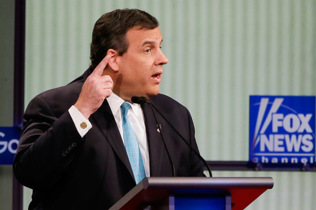 """Chris Christie  answers a question during the debate. He attacked Democratic front-runner Hillary Clinton, saying, """"She is not qualified to be president."""" The Associated Press"""