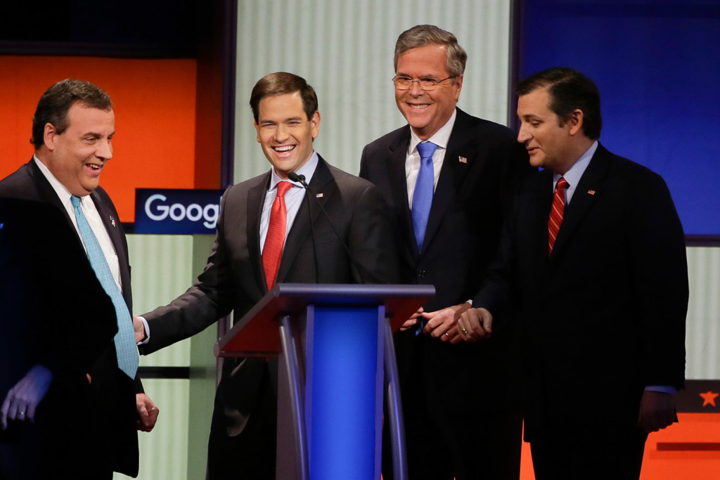 Republican presidential candidates, left to right, Chris Christie, Marco Rubio,  Jeb Bush and Ted Cruz talk after Thursday's debate, the last debate before the Iowa caucuses and the first held without Donald Trump. The Associated Press