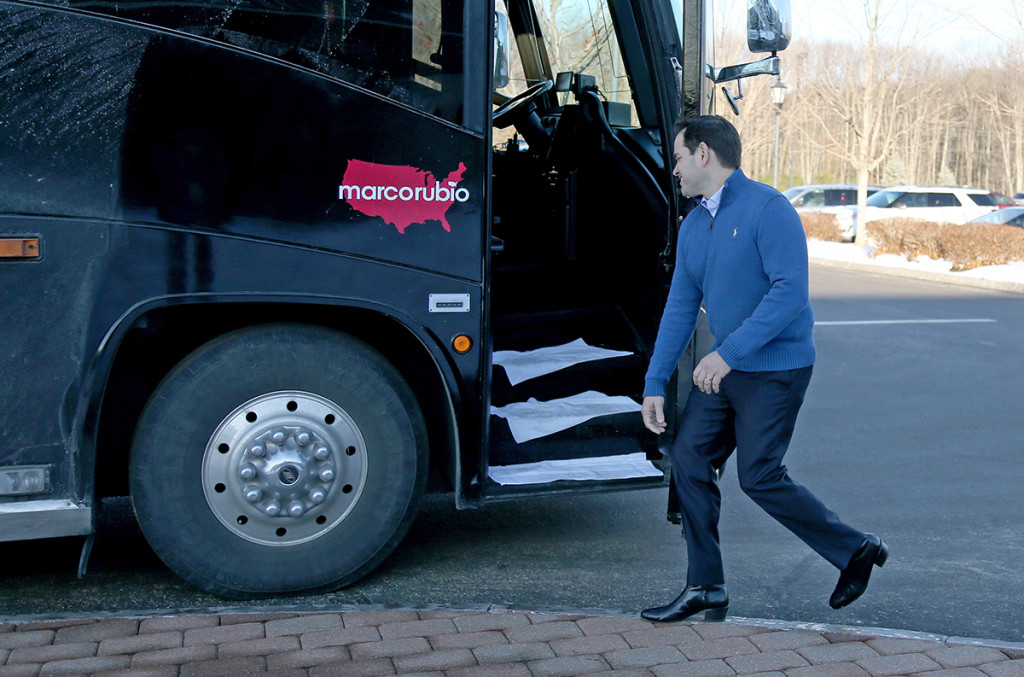 Republican presidential candidate Sen. Marco Rubio, R-Fla., gets on his bus after a campaign stop Sunday in Atkinson, N.H. The Associated Press