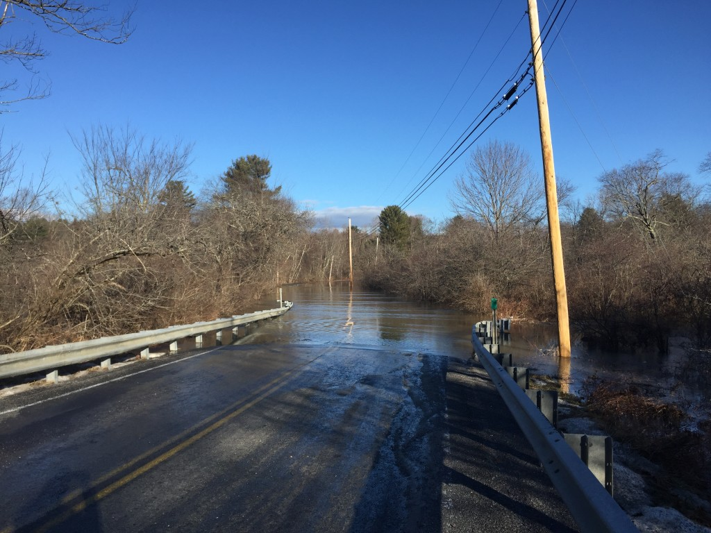 West Pownal Road in North Yarmouth is closed on Monday morning, January 11, 2016, after heavy rains and snowmelt from a storm the previous day inundated the area.
