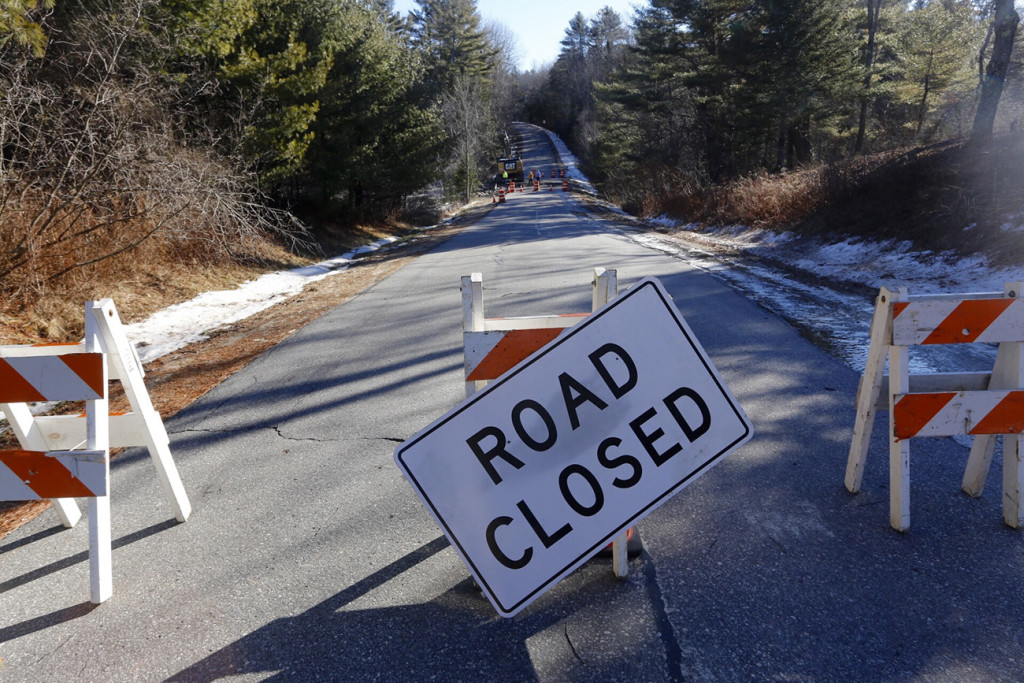 A section of Merrill Road in Pownal, near the Freeport town line, was closed on Monday until a culvert washed out in Sunday's storm could be repaired.  Derek Davis / Staff Photographer
