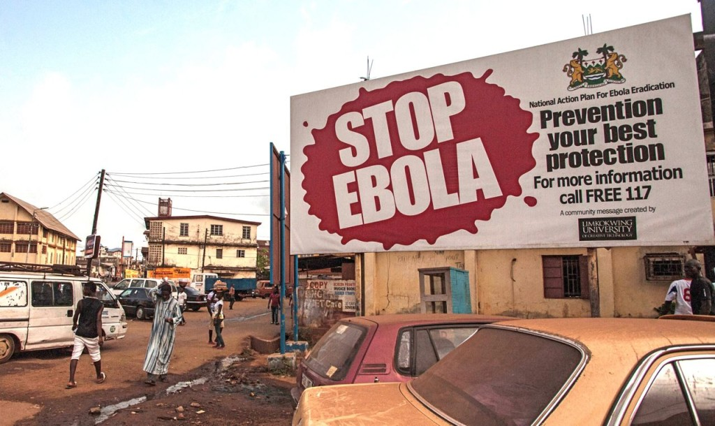 A banner reading 'STOP EBOLA' forms part of Sierra Leone's Ebola-free campaign in the city of Freetown. The Associated Press