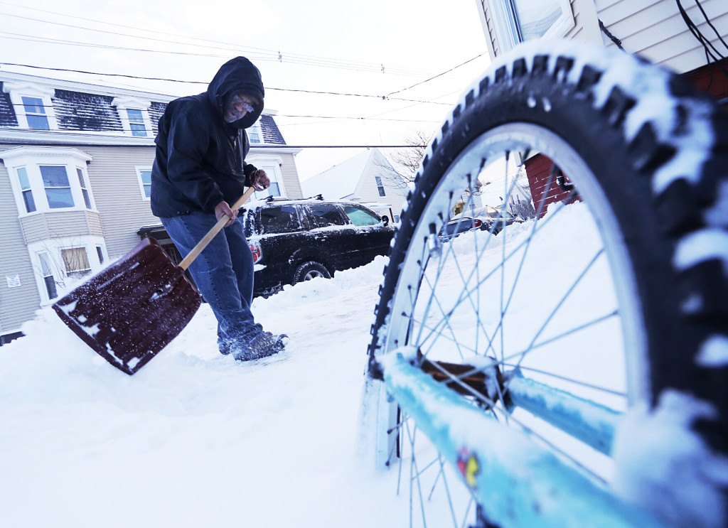 Harrison Rice shovels the sidewalk outside his Portland residence on Wednesday after an overnight storm left several inches of fresh snow. Derek Davis/ Staff Photographer