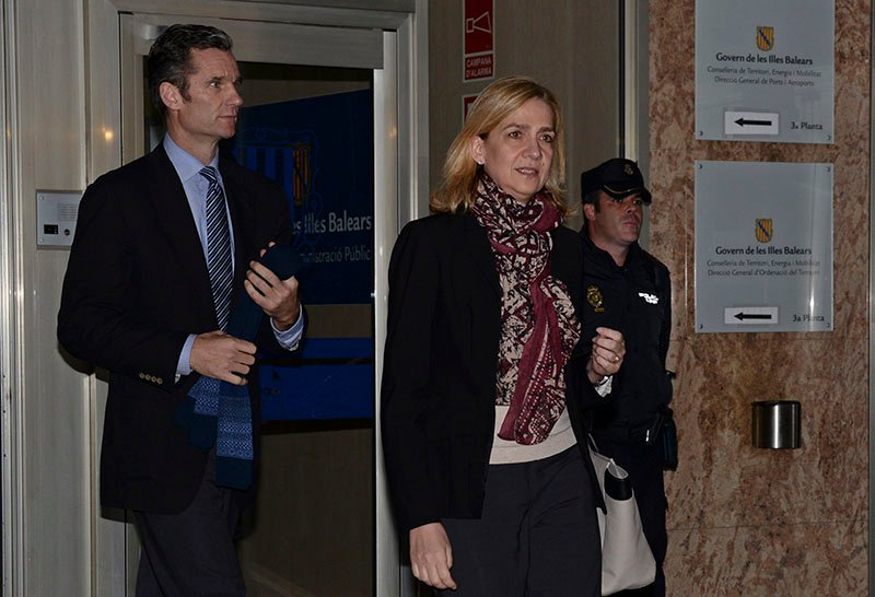 Spain's Princess Cristina, right and her husband Inaki Urdangarin, leave the courtroom after appearing in a corruption trial on January 11.