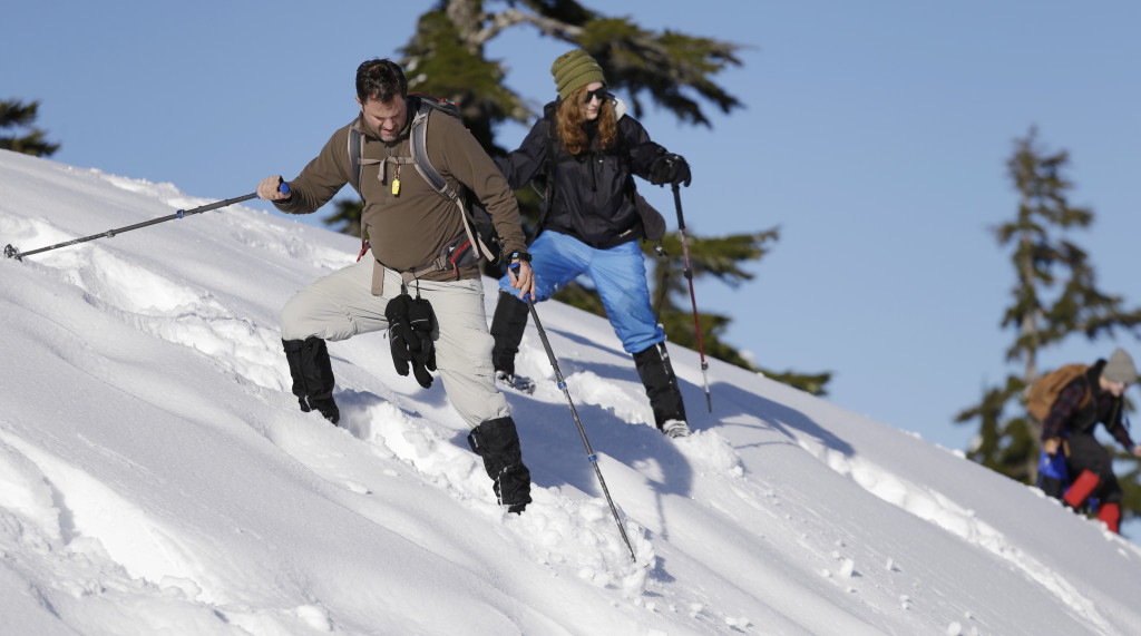 Steve Udd, a parent of a student in an avalanche program, and Gwyneth Lyman, 16, send small roller balls of snow ahead of them as they navigate a steep slope on snowshoes during an avalanche awareness field trip for teenagers at Mount Baker, Wash.