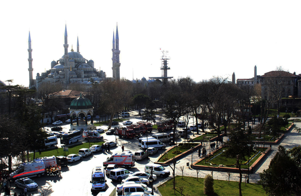 Ambulances and firefighters gather Tuesday near the Istanbul's landmark Sultan Ahmed Mosque or Blue Mosque after an explosion in the  historic Sultanahmet district, which is popular with tourists. IHA via AP