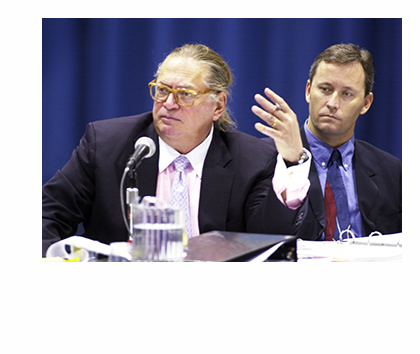 Shawn Scott, right, listens as one of his attorneys, Martin Gersten, questions a witness at a licensing hearing in 2003. Scott is the only person who meets the criteria for a proposed referendum question for a gambling establishment in York County.