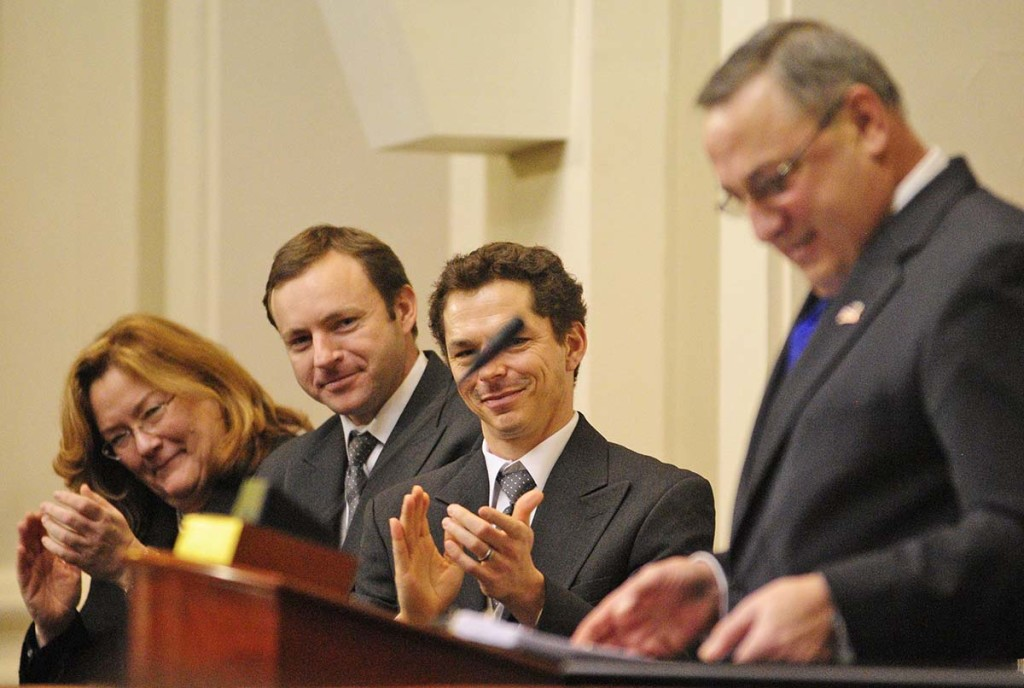 """Leigh Saufley, chief justice of the Maine Supreme Judicial Court, left, Speaker of the House Mark Eves, and then-Senate President Justin Alfond applaud during Gov. Paul LePage's State of the State address on Feb. 5, 2013. This year, LePage says, he's """"probably gonna go back to the 1800s and do it by letter."""" Joe Phelan / Kennebec Journal"""