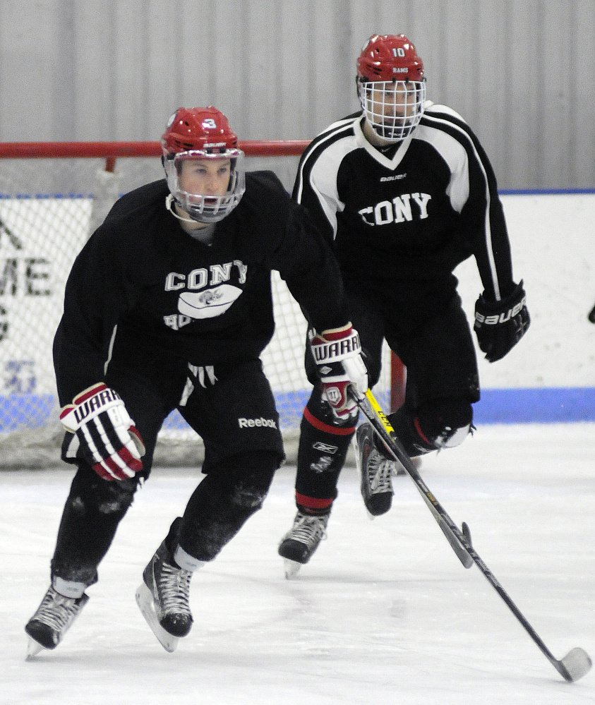 Cony High School hockey players Riley Boivin, right, and Connor Perry skate during practice Monday at the Ice Vault in Hallowell.
