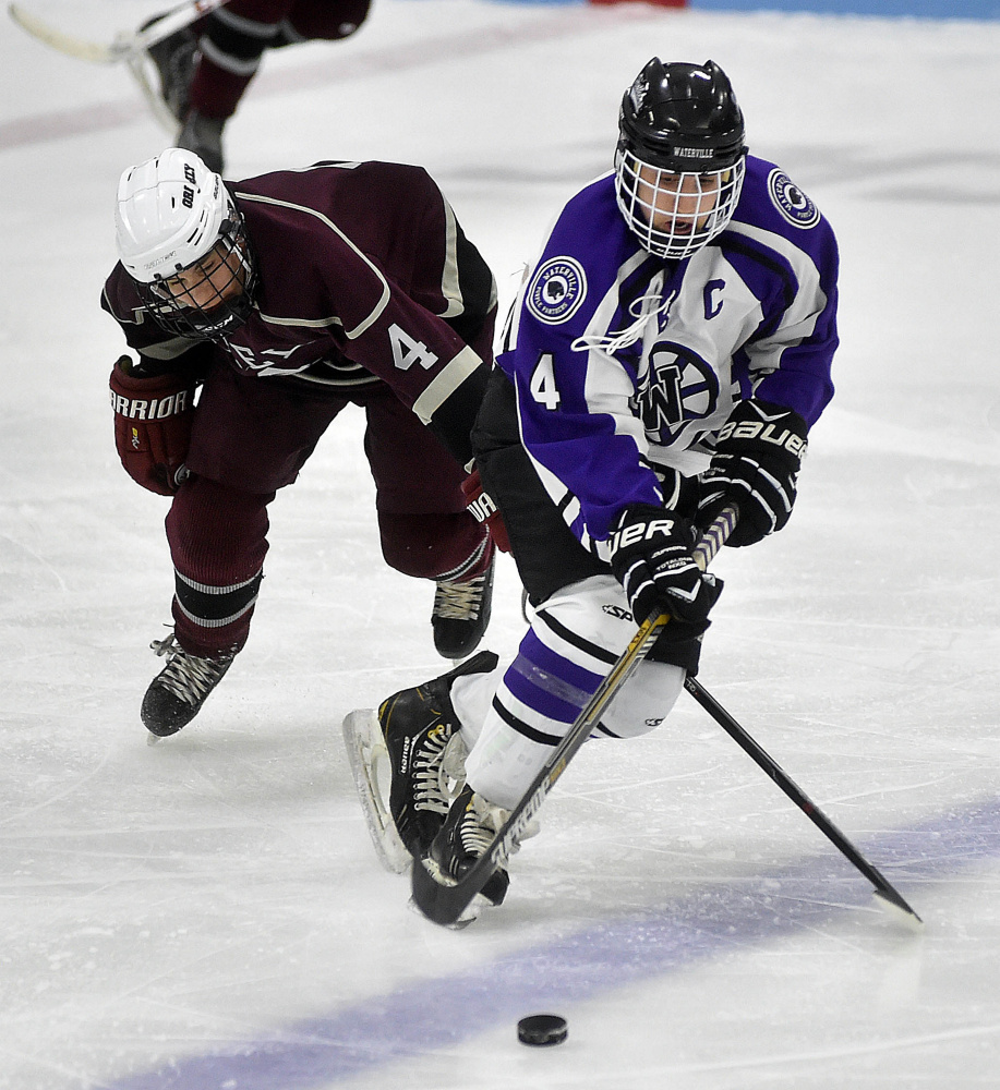Waterville forward Michael Oliveira skates past Greely's Colby Robinson (4) in the second period of a Dec. 17 game at Colby College. Oliveira is a big reason why the Panthers sit atop Class B North.