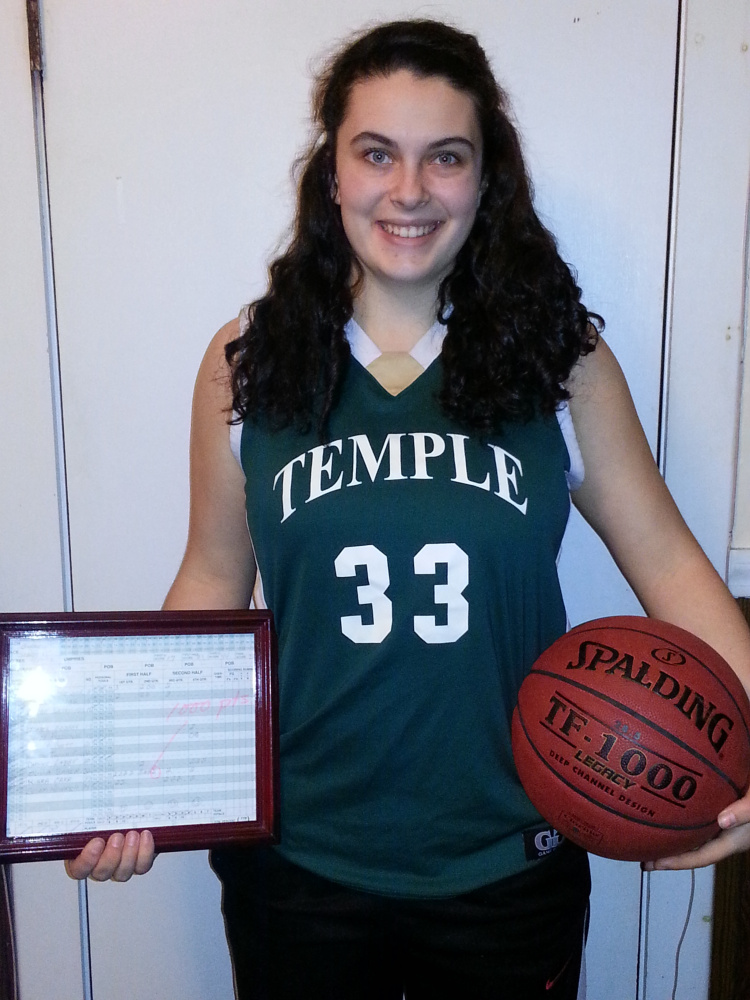 Temple junior Kiara Carr scored her 1,000th career point Saturday at Seacoast Christian. On Monday night, the school honored her with a game ball and a framed copy of the scoresheet.