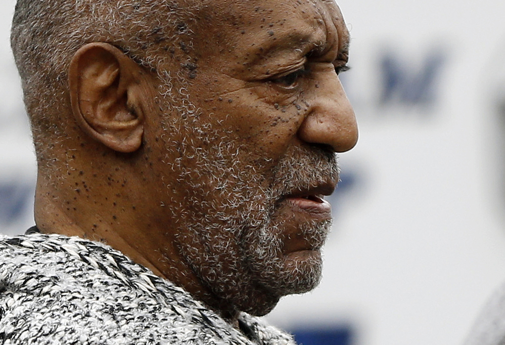 In this Wednesday, Dec. 30, 2015, file photo, Bill Cosby leaves the Cheltenham Township Police Department where he was processed after being arraigned on a felony charge of aggravated indecent assault in Elkins Park, Pa.