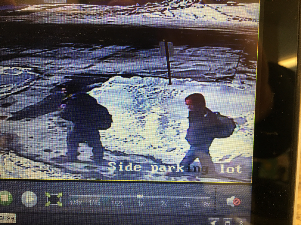 A surveillance image shows suspects who stole money from the Isaac F. Umberhine Library in Richmond.