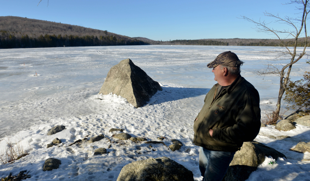John Terstegen, of Skowhegan, takes in the afternoon sunshine Tuesday as he fishes at Lake George Regional Park on the Canaan and Skowhegan town line.