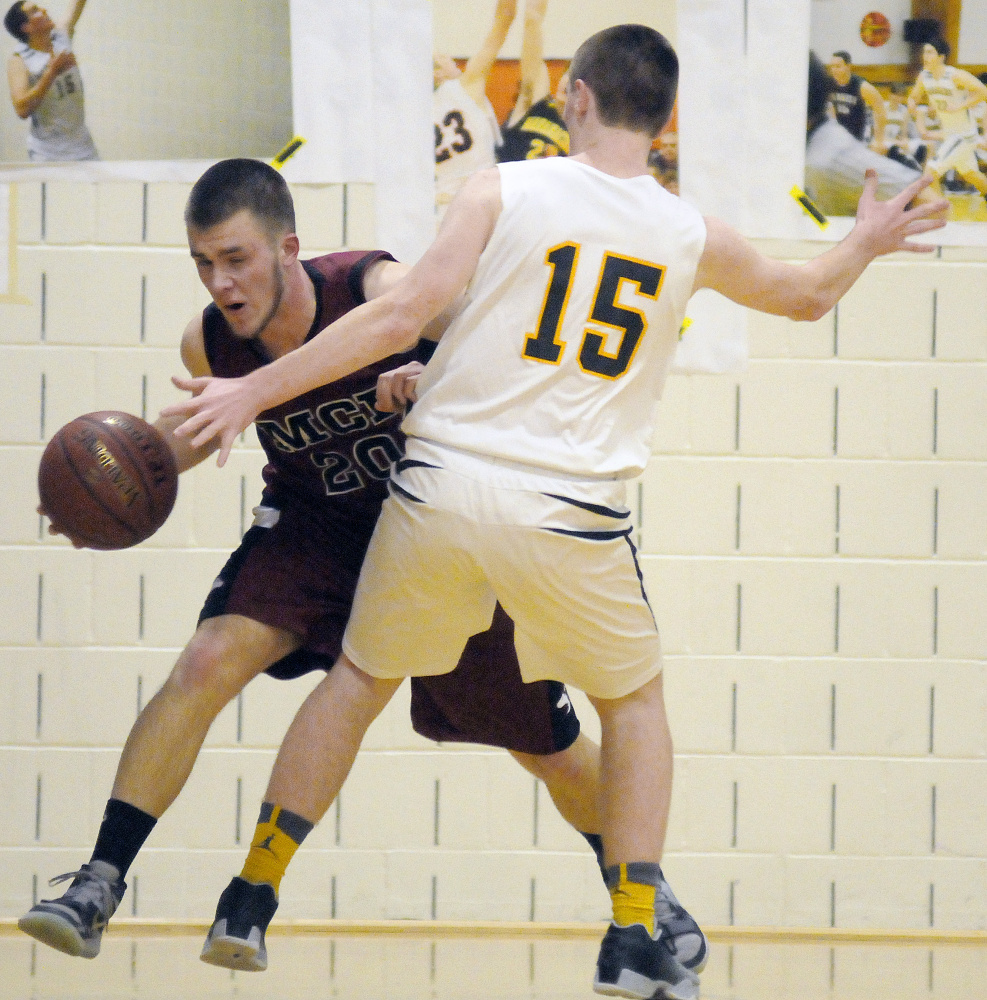 Maranacook's Jason Brooks (15) blocks Maine Central Institute's Carter Pearl during a game Tuesday in Readfield.