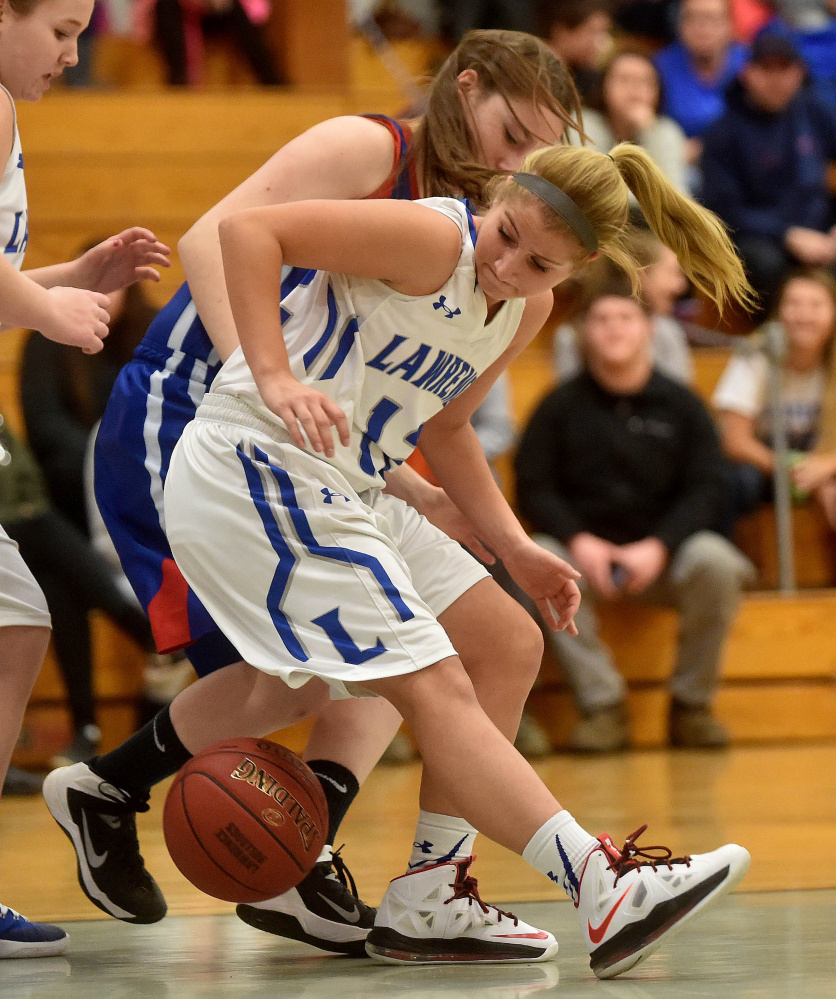 Lawrence senior guard Dominique Lewis looks for the ball as Messalonskee's Cassidy Baker defends during a Kennebec Valley Athletic Conference Class A game earlier this season in Fairfield. Lewis scored her 1,000th career point Tuesday night in Brewer. The team will honor her Thursday night.