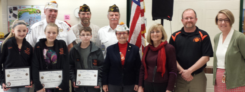 In front, from left, are Bailey Poore, who placed second; Mikayla Turner, first; Sam Farley, third; Debra Couture, Post 9 Patriot's Pen Chairperson; Donna Whelan, GRMS teacher and Patriot's Pen Chairperson; Todd Sanders, GRMS Principal; and Pat Hopkins, MSAD 11 Superintendent. Back from left are, Roger McLane, Post 9 commander; Roger Line, Post 9; and Greg Couture, Post 9.