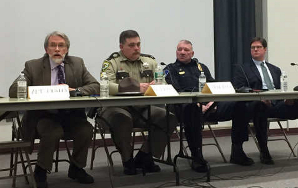 Psychiatrist Art Dingley talks as Oxford County Deputy Matt Baker, Farmington Police Chief Jack Peck and Franklin County District Attorney Andrew Robinson listen during a panel Wednesday night on heroin and opiate addiction in Franklin County.