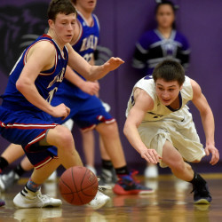 Waterville's Nicholas Dall, right, dives for the loose ball after Messalonskee's Nathan Violette knocked it loose Thursday in Waterville.