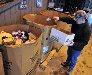 Dick Perkins tosses a can into a recycling bin on Friday at the Winthrop Transfer Station.