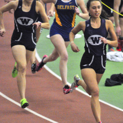 Waterville's Lauren Brown, left, and Cecilia Morin run 800 meters during KVAC indoor track championships on Saturday in Brunswick.