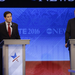 Republican presidential candidate, Sen. Marco Rubio, R-Fla., answers a question as Republican presidential candidate, businessman Donald Trump listens during a Republican presidential primary debate hosted by ABC News at the St. Anselm College  Saturday in Manchester, N.H.