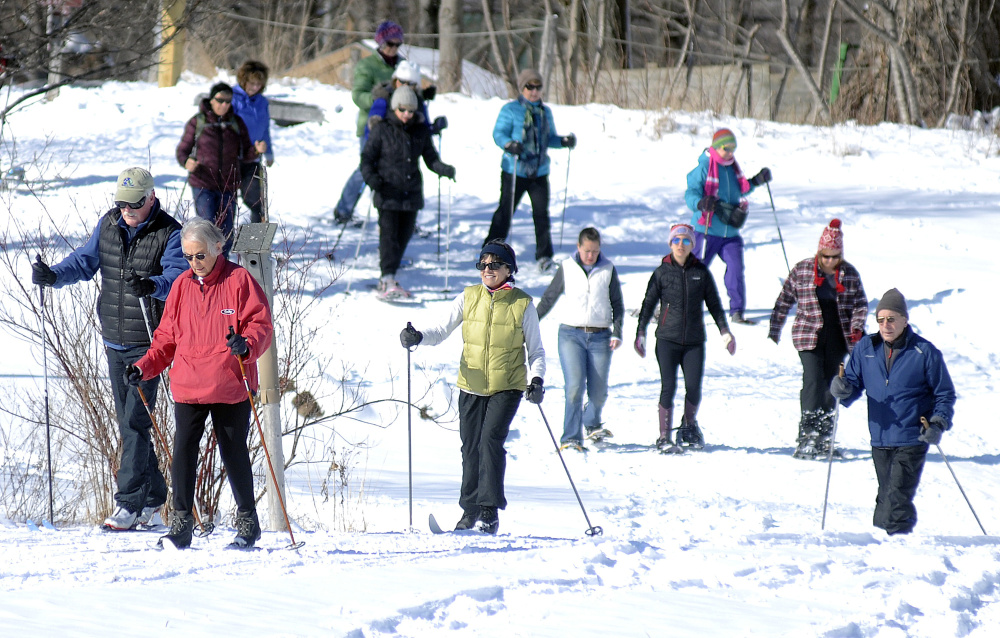 People ski and snowshoe Sunday across Viles Arboretum in Augusta during the Table Tour fundraiser.