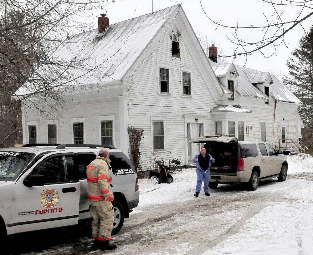 Fairfield Fire Chief Duane Bickford, left, and s fire marshal investigator Jeremy Damren prepare to enter a home on Middle Road in Fairfield on Monday after it was substantially damaged by a fire Sunday evening.