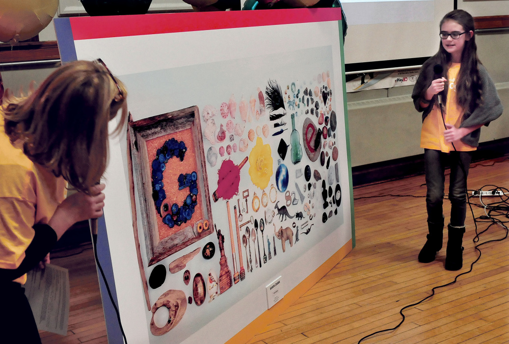 "Albert S. Hall School art teacher Hollie Hilton looks on as fifth-grade student Karin Zimba explains her artwork project ""Serendipity"" she created that was picked as the Maine winner in the annual national Doodle 4 Google contest. Her sister, Inga, won two years ago."