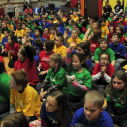 "Albert S. Hall School students, during a school assembly Monday, wear Google T-shirts and ask questions of fifth-grade student Karin Zimba about her art project ""Serendipity"" that was selected as the Maine winner in the national Doodle 4 Google contest."