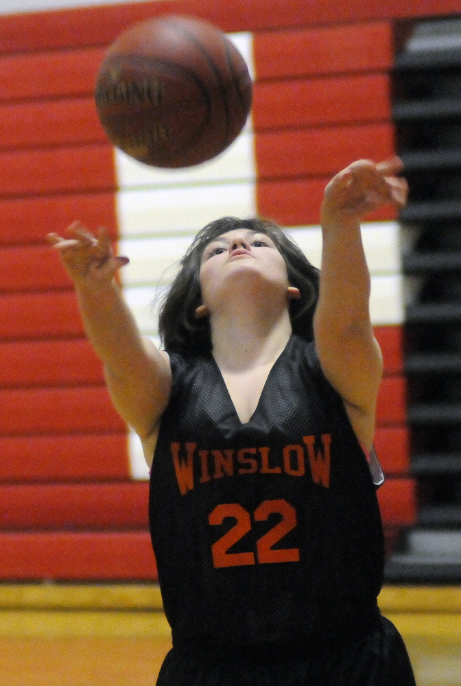 Winslow High School's Cheyenne Raymond shoots during a unified basketball game Monday against Cony in Augusta.